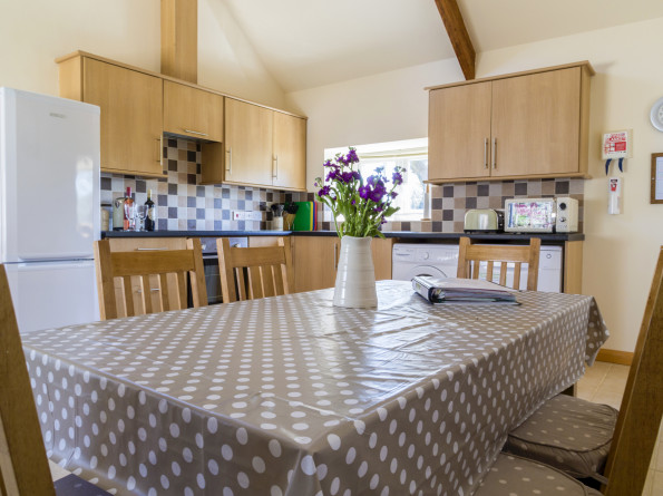dining area in the farmhouse kitchen in the 3 bedroom ground floor holiday cottage the Milking Parlour at Cwmcrwth Farm & Holiday Cottages in West Wales